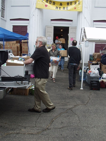 MACUCC Staff loading a truck with supplies at First Congregational Church, Brimfield